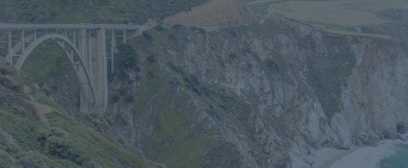 Background Image of Hillside Bridge and Beach