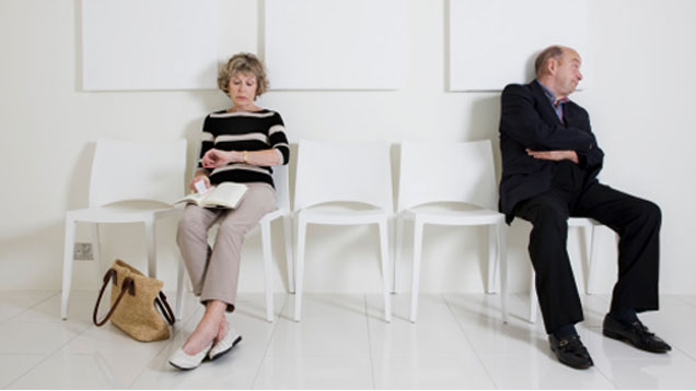 Unhappy Older Man and Woman Seats Apart